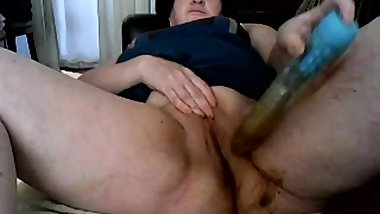 Aunt plays with toy in her dirty ass to pussy