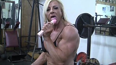Blonde mature muscle chick has a big clit