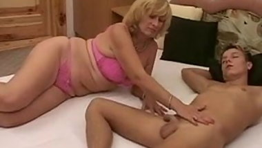 Mom wakes up her son by giving him a blowjob